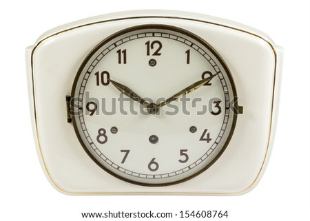 Beautiful old ceramic kitchen clock with metal pointers isolated on white - stock photo