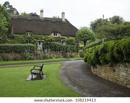 Beautiful old cottage with thatched roof and great hedges in the village of Chipping Campden, Cotswold, United Kingdom.