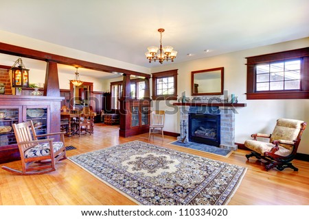Beautiful old craftsman style home living room interior with fireplace. - stock photo