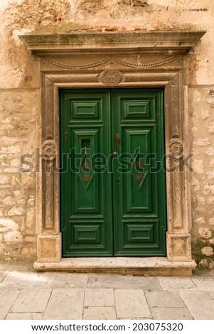 Beautiful old green wooden in historic Sibenik, Croatia - stock photo