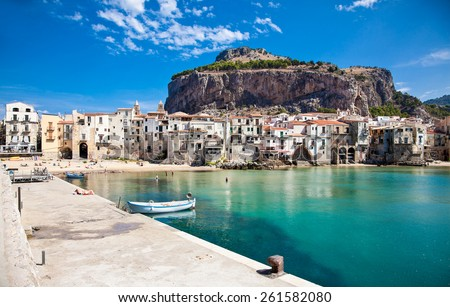 Beautiful old harbor with wooden fishing boat in Cefalu, Sicily, Italy. - stock photo