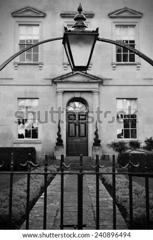 Beautiful Old Lantern and Iron Gateway to a Luxurious English Town House - stock photo