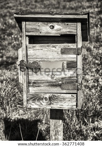 beautiful old letterbox at a meadow - stock photo