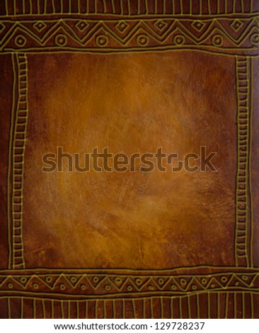 Beautiful old paper .Golden brown background African gold ornament Vintage background