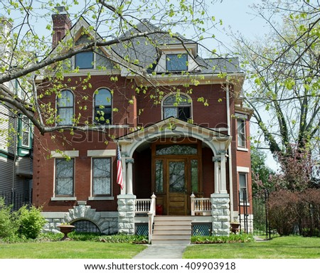 Beautiful Old Red Brick Home, Richardsonian Romanesque style - stock photo