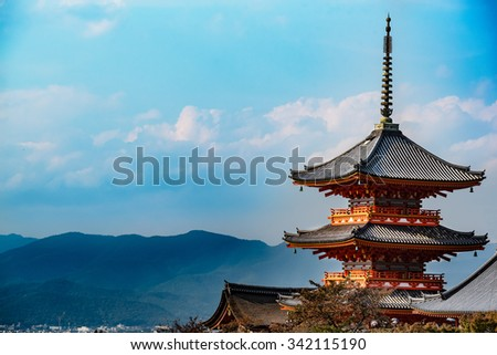 Beautiful old red wooden pagoda in Kyoto, Japan - stock photo