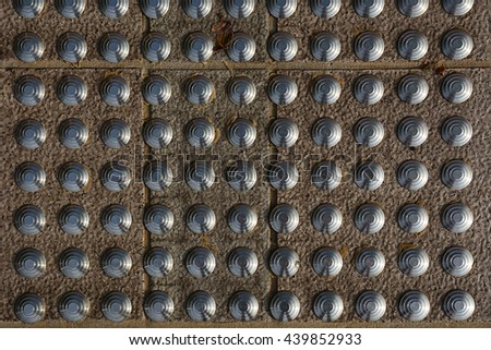 Beautiful old round stone wall texture with iron ornaments with metal ornaments