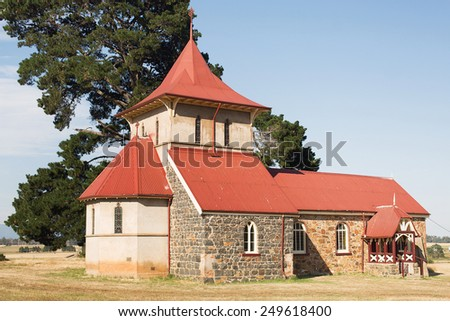 Beautiful old rural church on top of a hill - stock photo