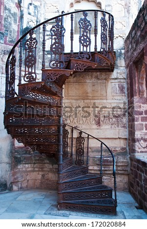 Beautiful old spiral staircase in Mehrangarh fort, Jodhpur, Rajasthan, India  - stock photo