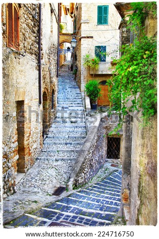 beautiful old streets of medieval italian villages, artistic vin - stock photo
