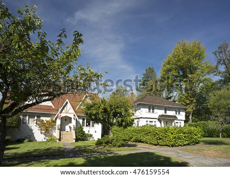 Beautiful old style homes. Gorgeous spring day with blue skies white clouds. Just one of many new house photos in my gallery.