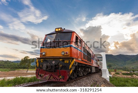 beautiful old train diesel at white bridge Lamphun province,Thailand - stock photo