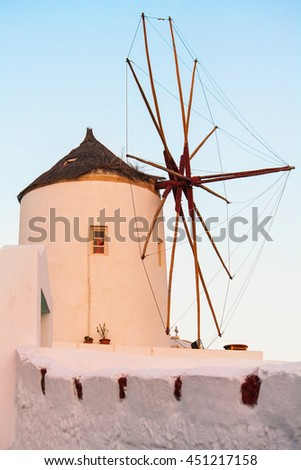 Beautiful old windmill in Santorini at the end of the day. These windmills are traditional for Cycladic islands, Greece. - stock photo