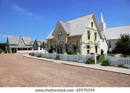 Beautiful old yellow house in summer - stock photo