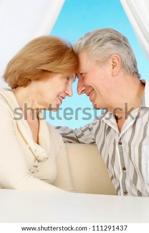 Beautiful older couple resting in the bedroom after a hard working week