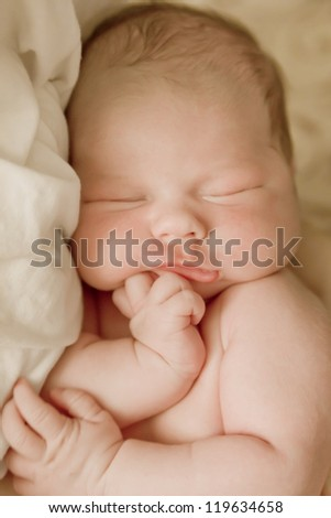 Beautiful one week old baby boy a sleep. - stock photo