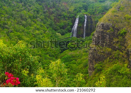 Beautiful Opaekaa Falls in a lush valley on the island of Kauai, Hawaii
