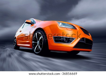 Beautiful orange sport car on road - stock photo