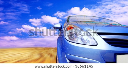 Beautiful orange sport car on road - stock photo