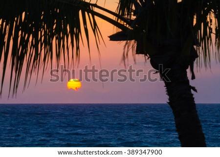 Beautiful orange sunset in Hawaii - stock photo