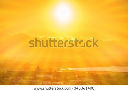 Beautiful orange sunset over european city with sun rays. Cagliari, Sardinia, Italy. - stock photo