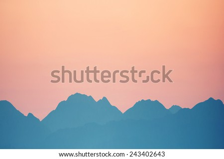 Beautiful orange sunset over mountains. Cagliari, Sardinia, Italy.