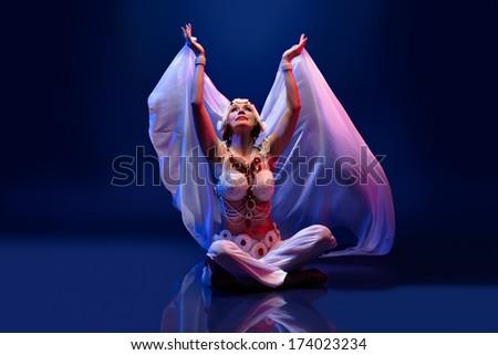 Beautiful oriental dancer - stock photo