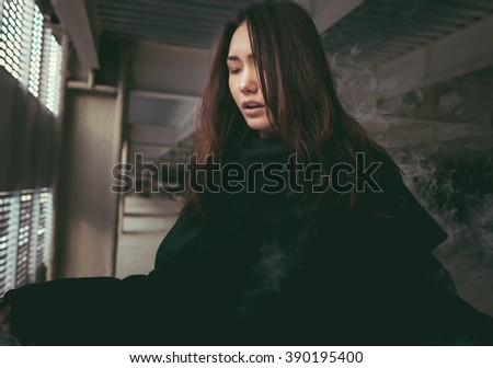 Beautiful oriental young woman in front of loft window. Fashion style portrait.