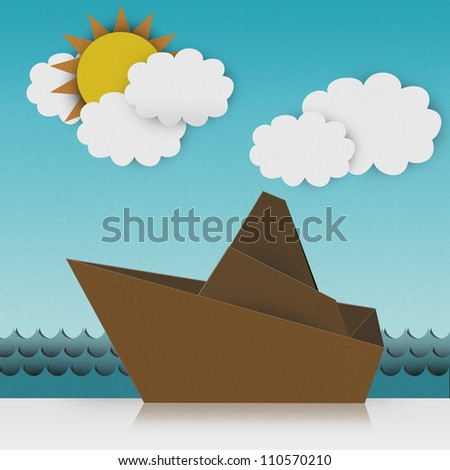 Beautiful Origami Made From Recycle Paper, Boat Sailing in The Sea With Sunny and Blue Sky Background - stock photo
