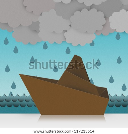 Beautiful Origami Made From Recycle Paper, Boat Sailing in The Sea With The Storm and The Rain Drop Background - stock photo