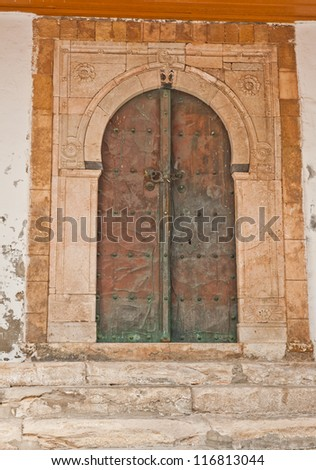 Beautiful ornamental door of so typical shape for Tunisia - stock photo