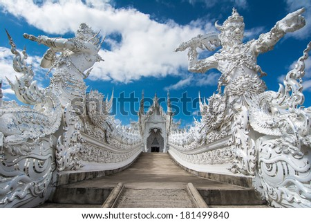 Beautiful ornate white temple located in Chiang Rai northern Thailand. Wat Rong Khun (White Temple), is a contemporary unconventional Buddhist temple. - stock photo