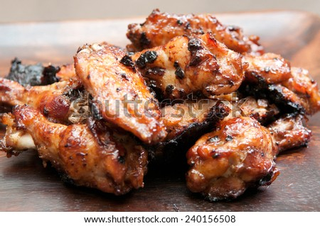 beautiful oven roasted chicken wings with barbeque sauce - stock photo