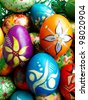 Beautiful painted easter eggs on a colorful background - stock photo