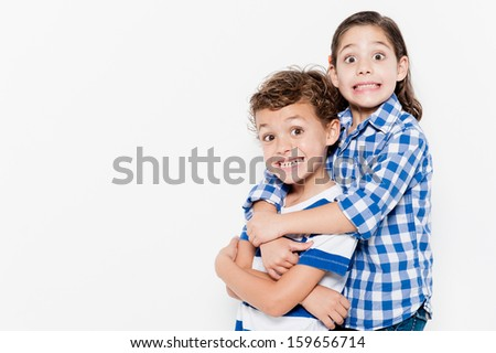 Beautiful pair of brothers. Boy and girl - stock photo