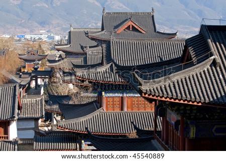 beautiful palace roofs in Lijiang, China - stock photo