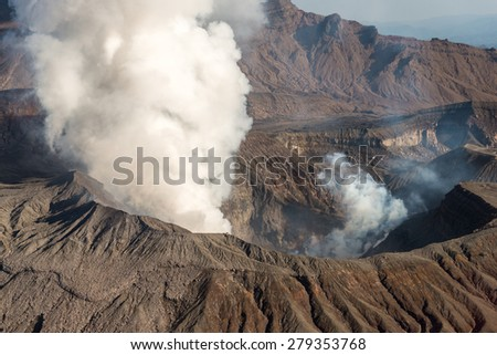 Beautiful Panorama Aerial View Smoke Gas Steam Crater of Mount Aso Volcano Caldera Ropeway largest active Volcano in Japan Island eruption under Sunny Clear Blue Sky in Summer Daytime, Kumamoto,Kyushu - stock photo