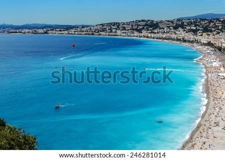 Beautiful panorama city of Nice - luxury resort of French Riviera. Cote d'Azur France. Mediterranean Sea, public beach, Promenade des Anglais, palms and houses of Nice. - stock photo