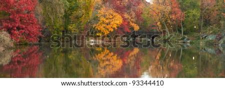 Beautiful panorama of Fall colors at Oak Bridge (Bank Rock bay), Central Park. New York City - stock photo