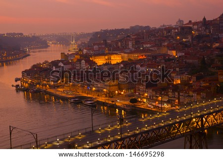 beautiful panorama of Ribeira and Douro river at sunset, Oporto, Portugal