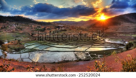 Beautiful panorama of the landscape of Madagascar with rice plantations and a nice cloudscape - stock photo