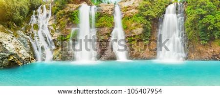 Beautiful panorama of waterfalls at summer day - stock photo