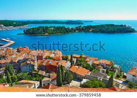 Beautiful panoramic aerial view from the bell tower of the Eufemije cathedral to historical centre and harbour of old town  Rovinj (Rovigno).Natural landscape at sunny day.  Istria. Croatia.Europe. - stock photo
