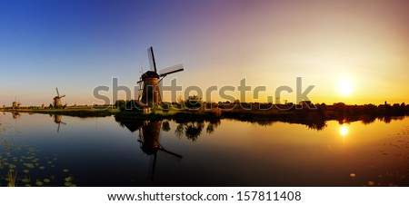 Beautiful panoramic image of the dutch windmills at Kinderdijk, the Netherlands. An UNESCO world heritage site. HDR - stock photo