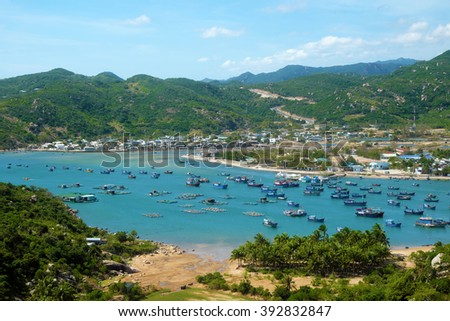 Beautiful panoramic landscape of Vietnam beach, Vinh Hy bay, Ninh Thuan, group of boat anchor at fishing village, fantastic holiday when travel at Viet Nam in summer or spring