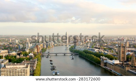 Beautiful panoramic scenic view on London's southern part from London Eye tourist attraction wheel: cityscape, The Houses of Parliament, Big Ben, St. Thomas Hospital and Thames river - stock photo