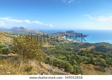 Beautiful panoramic view from the height on the Cretan village of Plakias with its picturesque hilly relief, beach and coastline of mediterranean sea.District of Rethymno.Crete island.Greece.Europe. - stock photo
