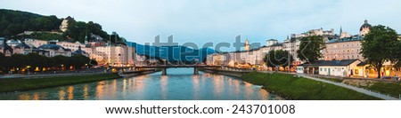 Beautiful panoramic view of Salzburg skyline with Festung Hohensalzburg and Salzach river at blue hour, Salzburger Land, Austria - stock photo