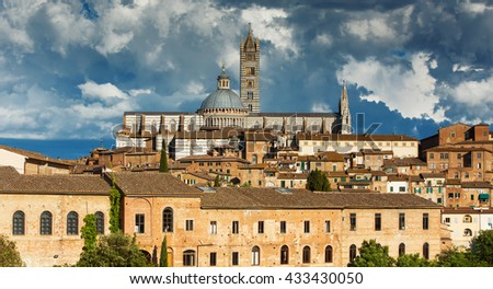 Beautiful panoramic view of the historic city center of Siena at sunset with an amazing cloudscape on an idyllic summer evening, Tuscany, Italy - stock photo