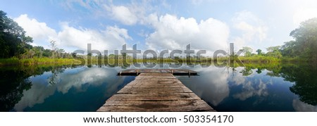 beautiful panoramic view of the pond with a wooden pier. Guatemala